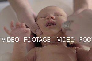 Newborn baby crying when bathing