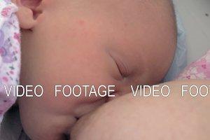 Nursing newborn baby