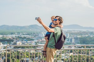 Father and son on High view from Phuket View Point Rang Hill in Phuket Thailand