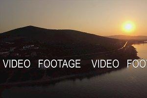 Aerial view of Trikorfo Beach coastline at sunset, Greece