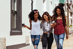 Friends walking on street