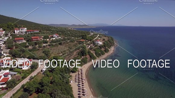 Flying Over Sea Cottages And Resort On The Coast Trikorfo Beach Greece