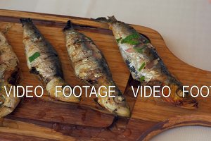 Pouring sardines with lemon juice before eating