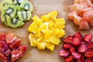Various chopped fruits on wooden