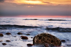 Colorful sunrise on a rocky beach