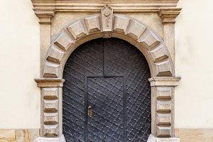 Old metal arch door
