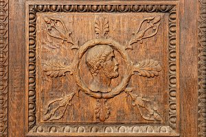 Face carved on wooden door