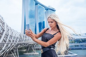 Young slim blonde woman girl takes selfie photo pictures near Ga