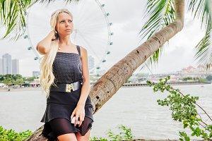 Pretty blonde tourist woman in Singapore