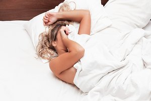 Woman in the bed don't want to wake up in morning