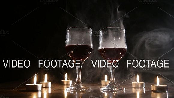 Wine Glasses And Burning Candles In The Smoke
