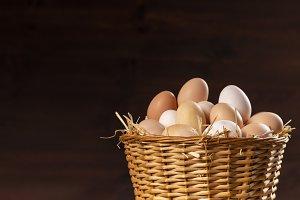 wicker basket with fresh farm eggs
