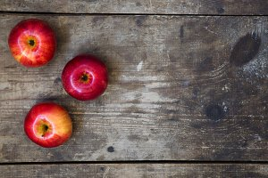 Ripe red apples on dark wooden