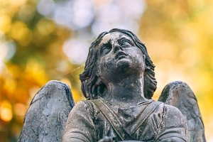 Sculpture of an angel in a cemetery