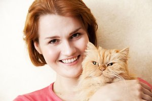 Smiling woman with Persian cat