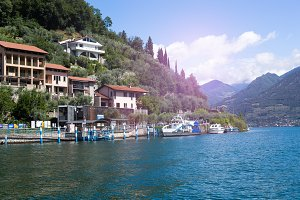 Public waterway shuttle and architecture on the island of Monte Isola, Lake Iseo, Italy