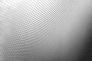 Diagonal carbon hole apertures texture background