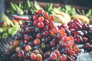 Grape on the asian balinese indonesian night market. Organic fruits. Bali.