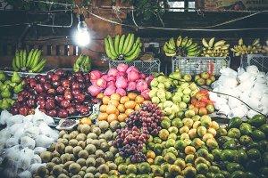 Variety of fresh fruits on organic food night market. Bali island, Indonesia.
