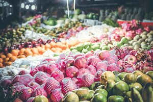 Variety of fresh fruits on organic food night market. Bali island, Indonesia.