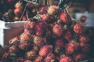 Rambutan fruits on the asian night market. Bali island.