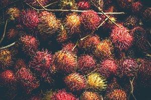 Rambutan fruits on the asian night market. Bali island.
