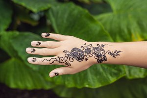 Picture of human hand decorated with henna Tattoo. mehendi hand