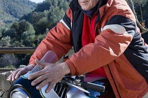 man caressing a motorbike