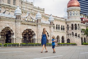 Mom and son on background of Sultan Abdul Samad Building in Kuala Lumpur, Malaysia. Traveling with children concept