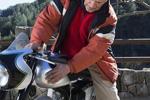 man caressing a motorcycle
