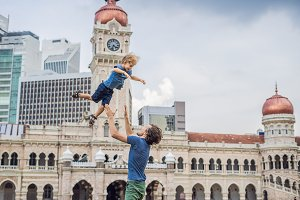 Dad and son on background of Sultan Abdul Samad Building in Kuala Lumpur, Malaysia. Traveling with children concept