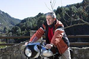 man sitting on a motorbike