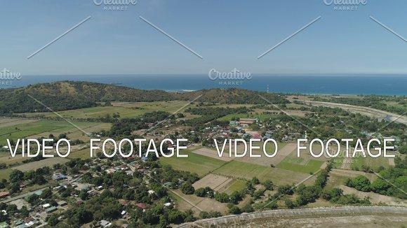 Town And Farm Fields Near The Sea
