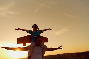 Father and son  at sunset in nature.