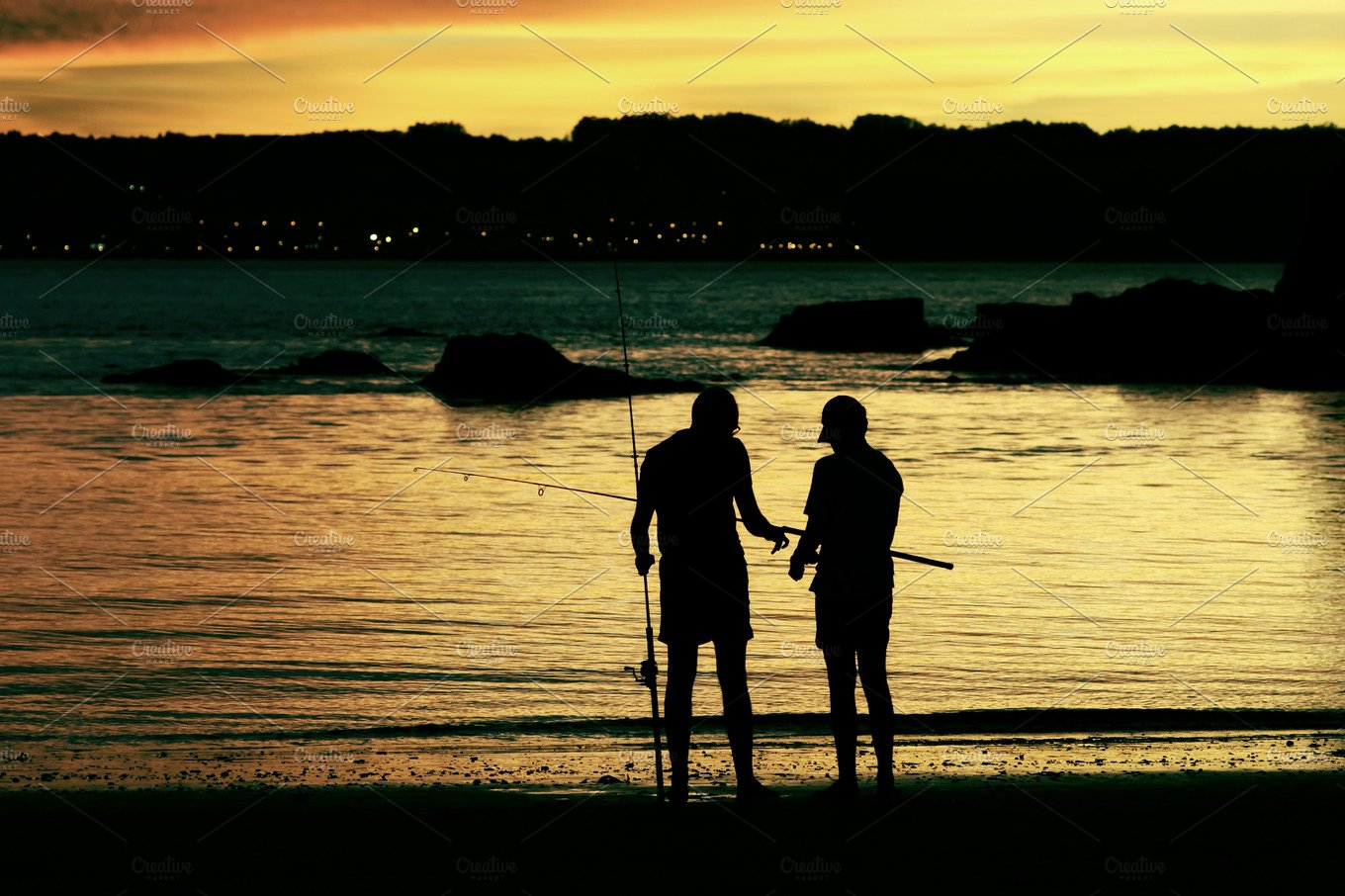 Father And Son Fishing On The Beach Sports Photos