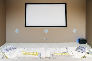 Home cinema with comfortable sofa couches in luxury home