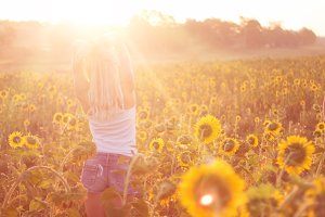 Beautiful girl in sunflowers.