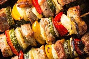 Grilled shish kebab with vegetables  on skewers.