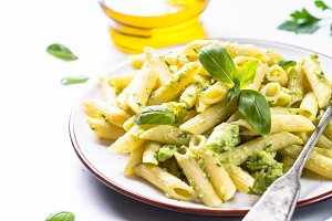 Vegan pasta penne with avocado and basil.