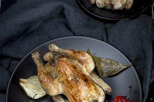 Roast chicken on black table