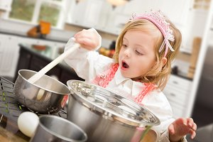 Baby Girl Playing Cook In Kitchen