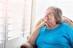 Senior Woman Gazing Out Window