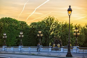 lone passerby on Alexander III bridge at dawn