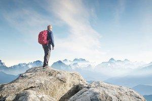 Tourist on mountain peak