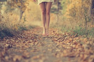 Beautiful female legs in the fall