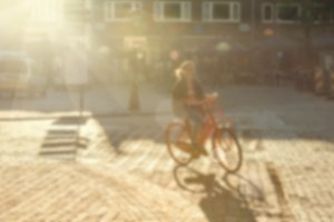 Blurred image of bicyclist on the