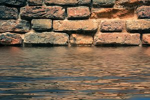 Red Brick Wall with Water