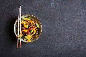Traditional asian salad with beef and vegetables. Top view