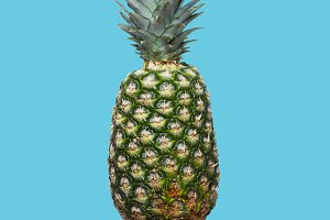 Fresh pineapple on the blue colorfurful background