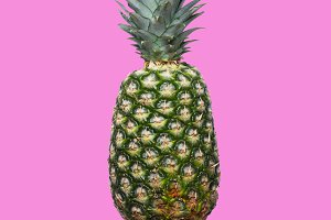 Fresh pineapple on the violet colorfurful background